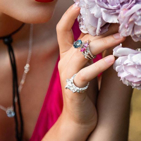ZYDRUNE Celestial 'Supernova 1006' Tourmaline ring lookbook in the field of roses. Close-up.
