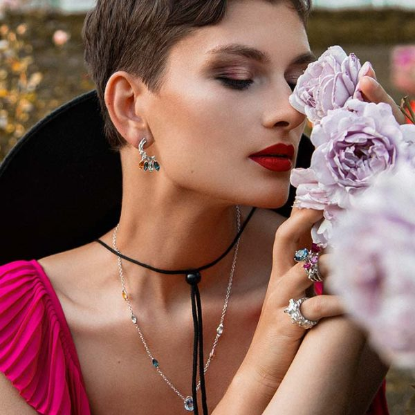 ZYDRUNE Celestial 'Trifid' necklace lookbook in the field of roses. Close-up.