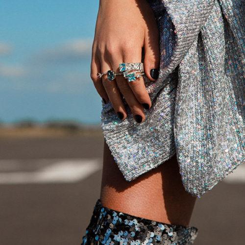Model close-up of Zydrune Celestial gemstone rings. Ethically made designer jewelry London.