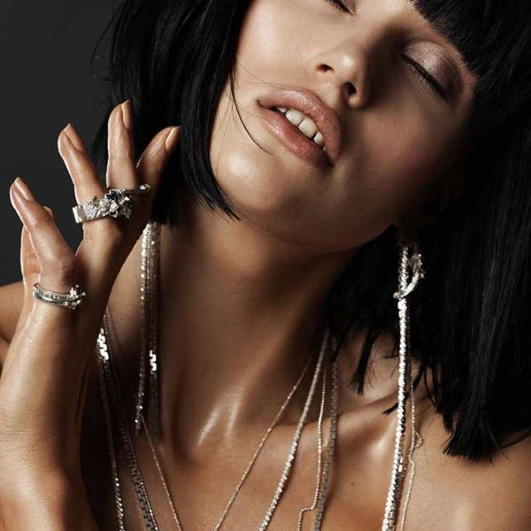 Zydrune Anomaly jewellery lookbook. Model wearing 'Avalanche' earrings and other Zydrune jewelry.