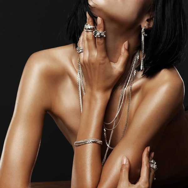 Zydrune Anomaly jewellery lookbook. Model wearing 'Flurry' chain earrings and other Zydrune jewelry.