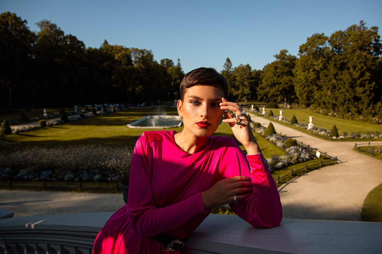 Model outside the palace, wearing Zydrune ethically made gemstone jewellery.