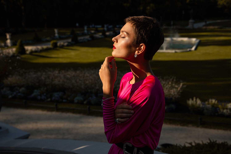 Model outdoors wearing Zydrune Topaz earrings.
