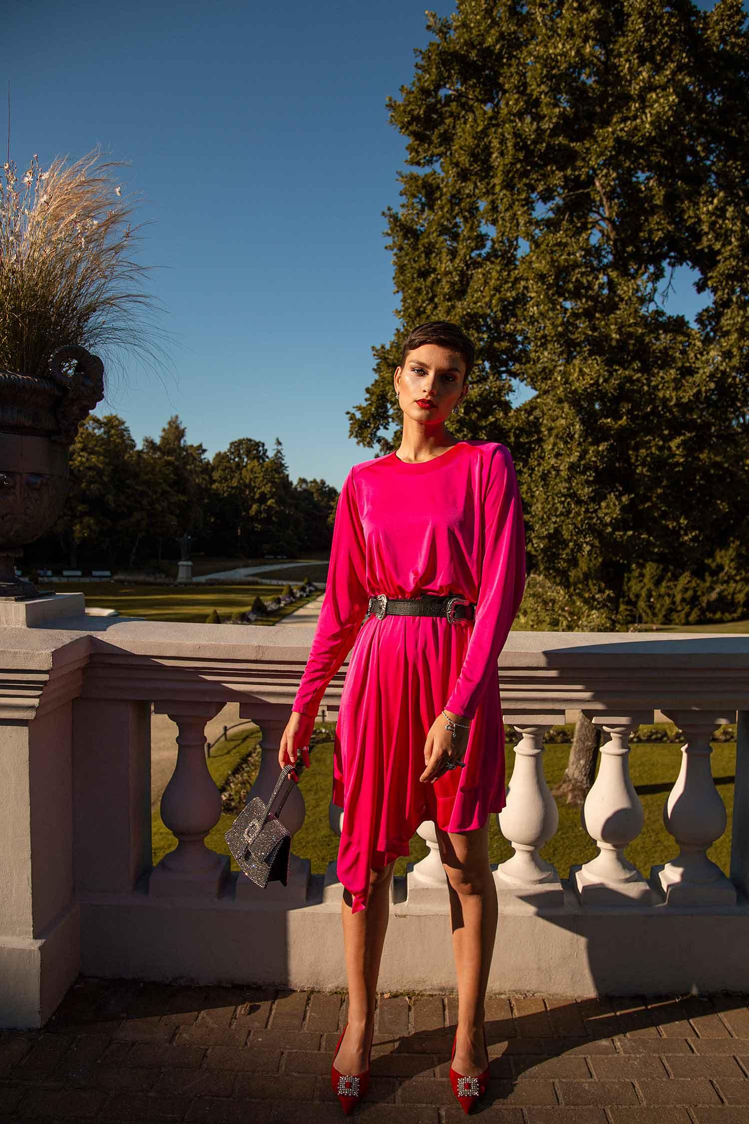 Model in pink vintage dress outdoors wearing Zydrune Celestial jewellery.