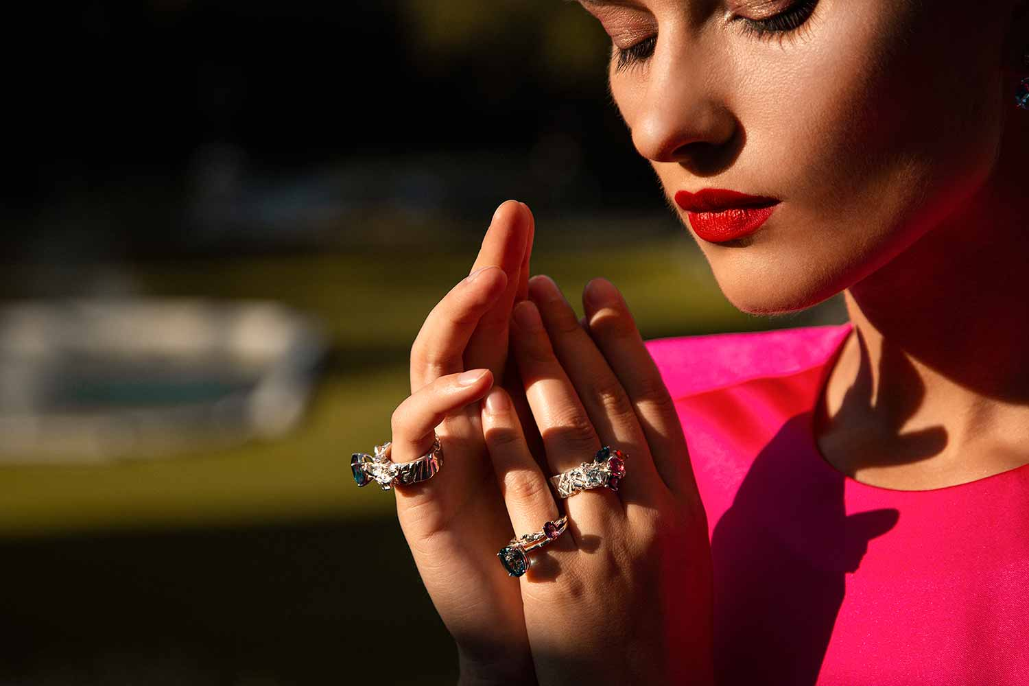 Close-up of model wearing statement and stacking rings from Zydrune jewellery collection.