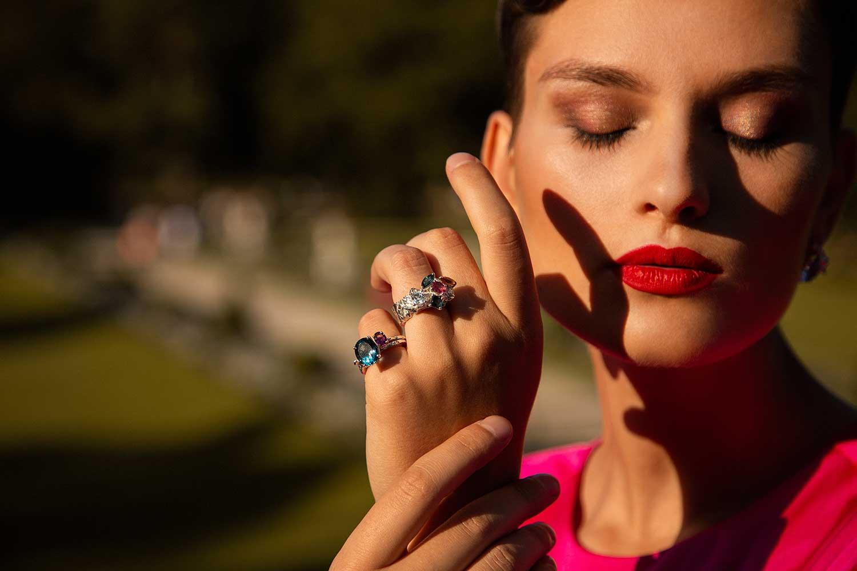 Close-up of model outdoors wearing Zydrune multi gemstone rings.