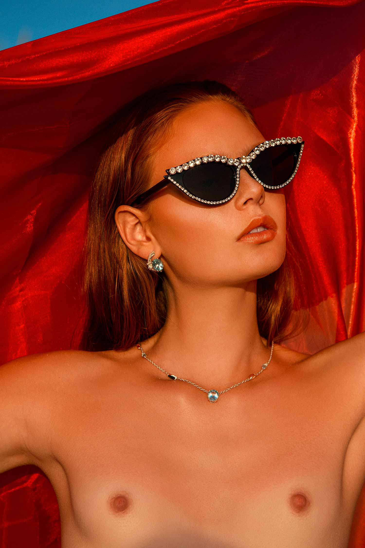 Colourful image of model wearing Zydrune ethically made Celestial jewellery.