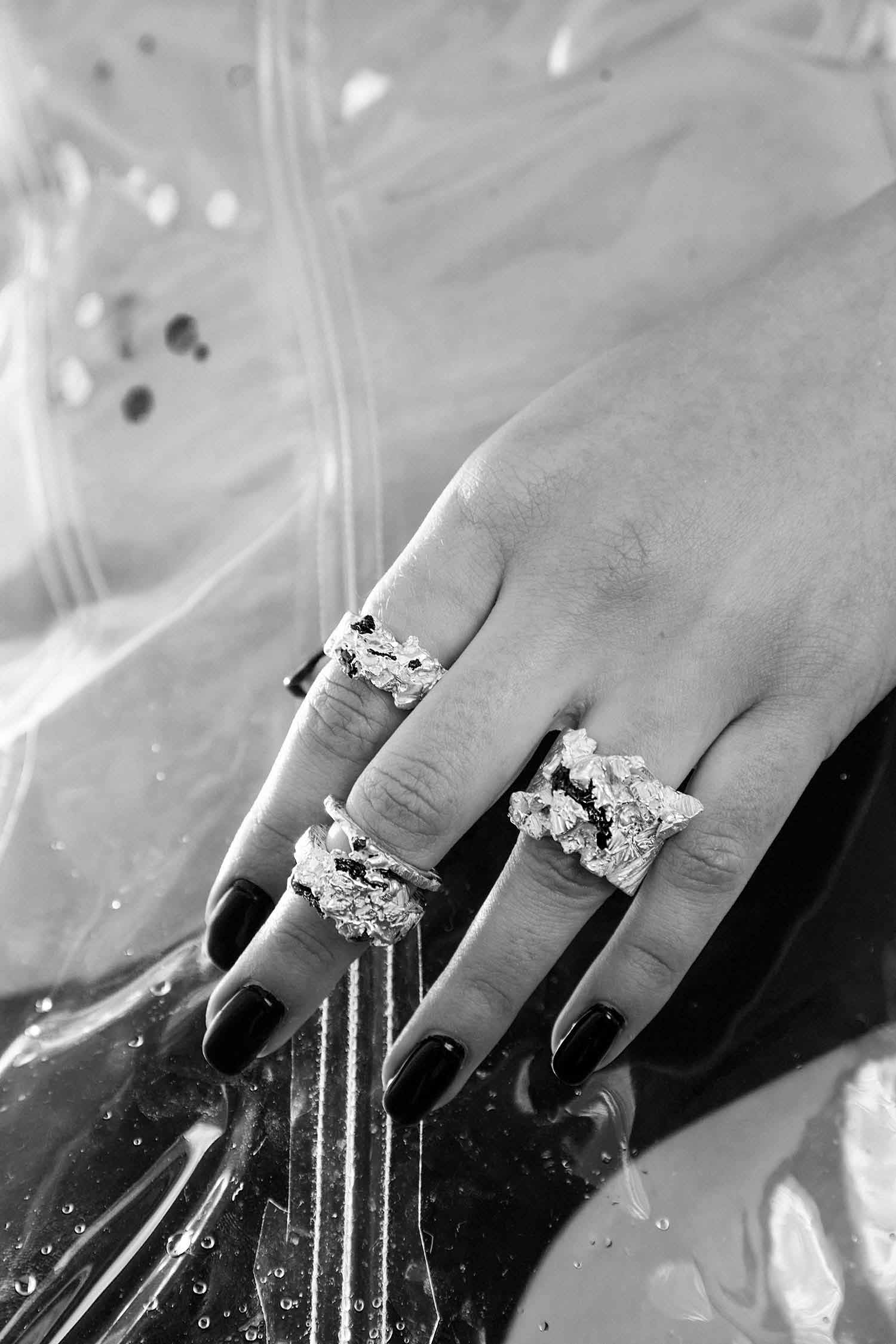 Close-up image of model hands with Zydrune Anomaly statement rings.