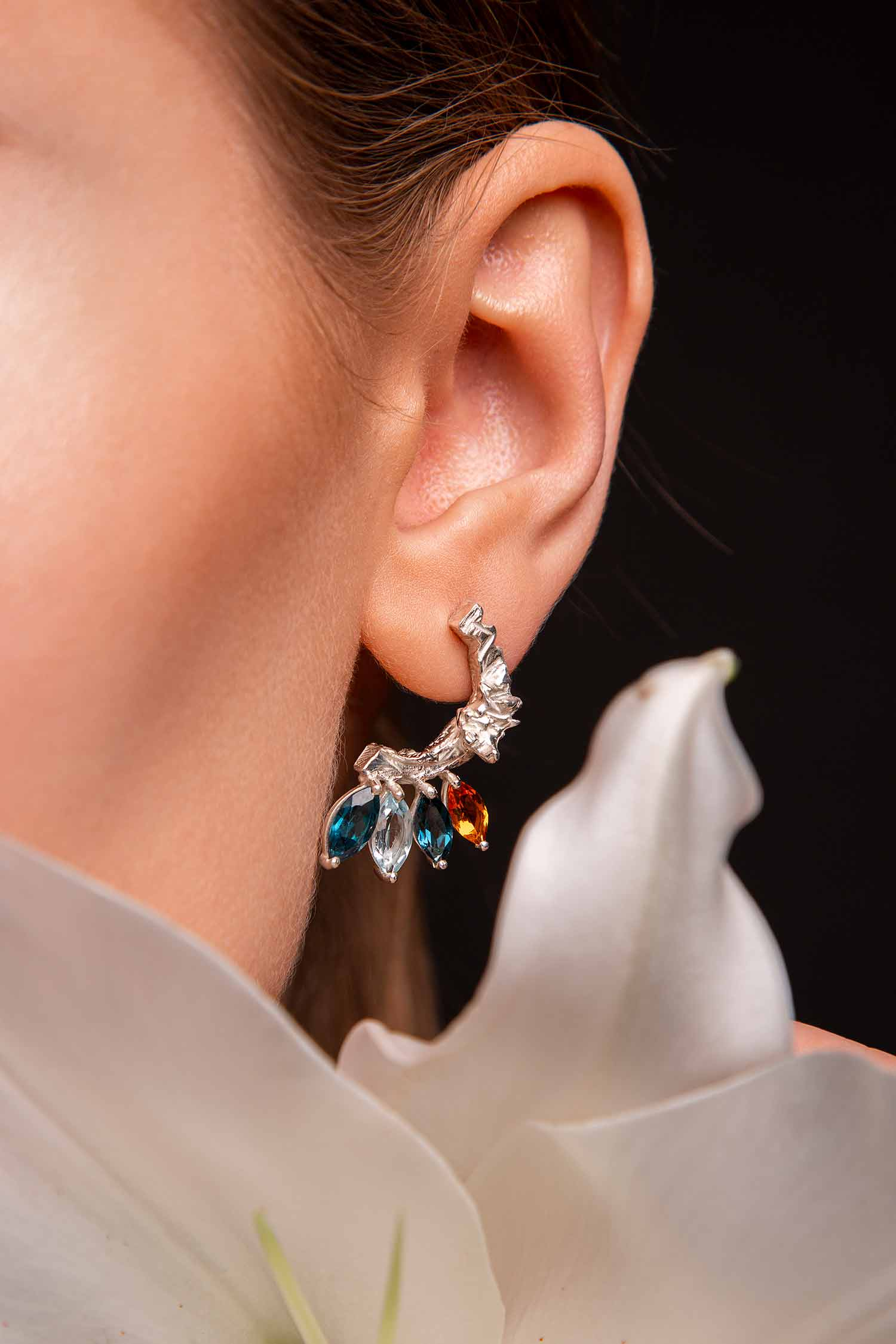 Close-up of model with Zydrune multi gemstone Celestial earrings.