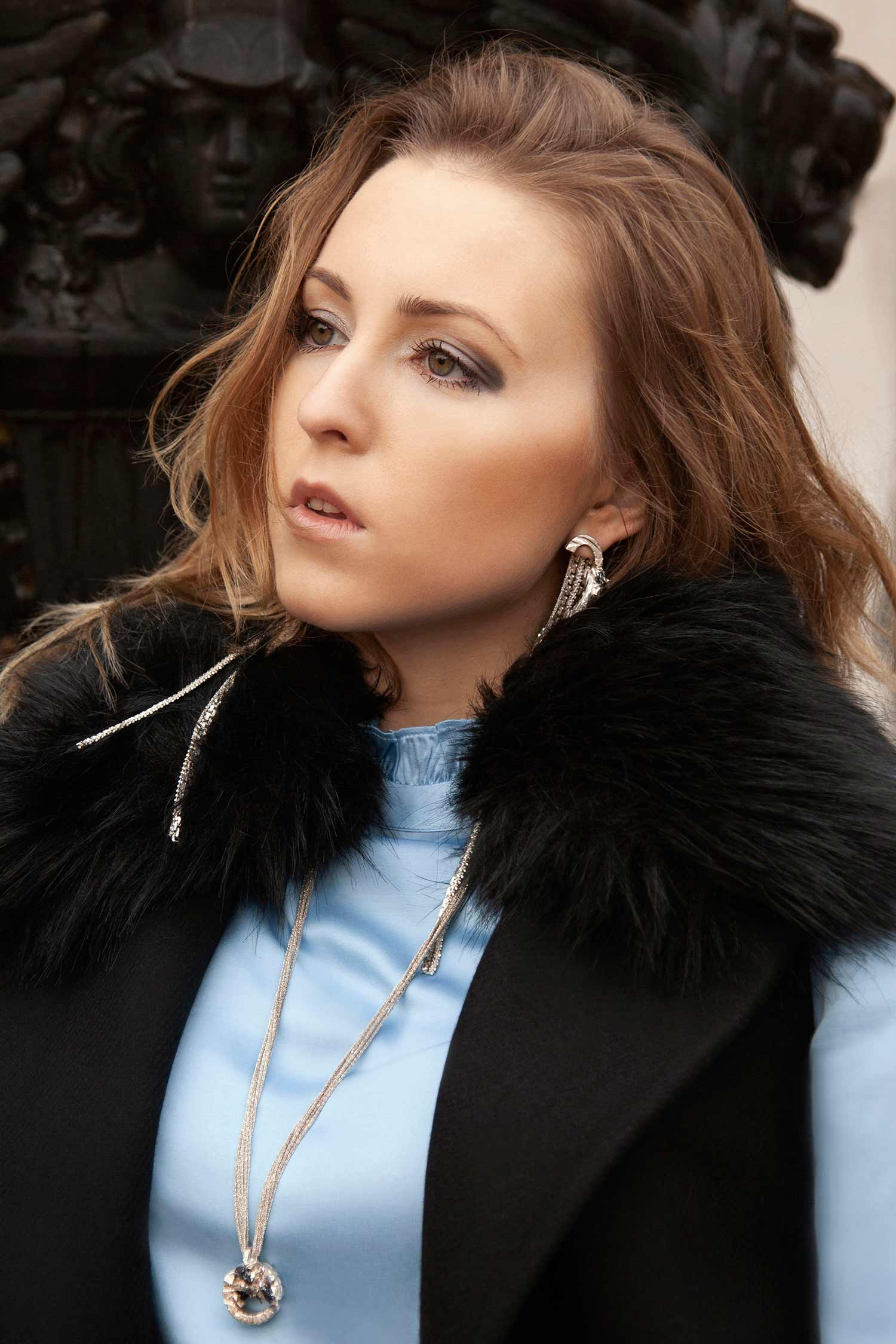 Portrait of model wearing Zydrune Anomaly statement earrings and handmade pendant.
