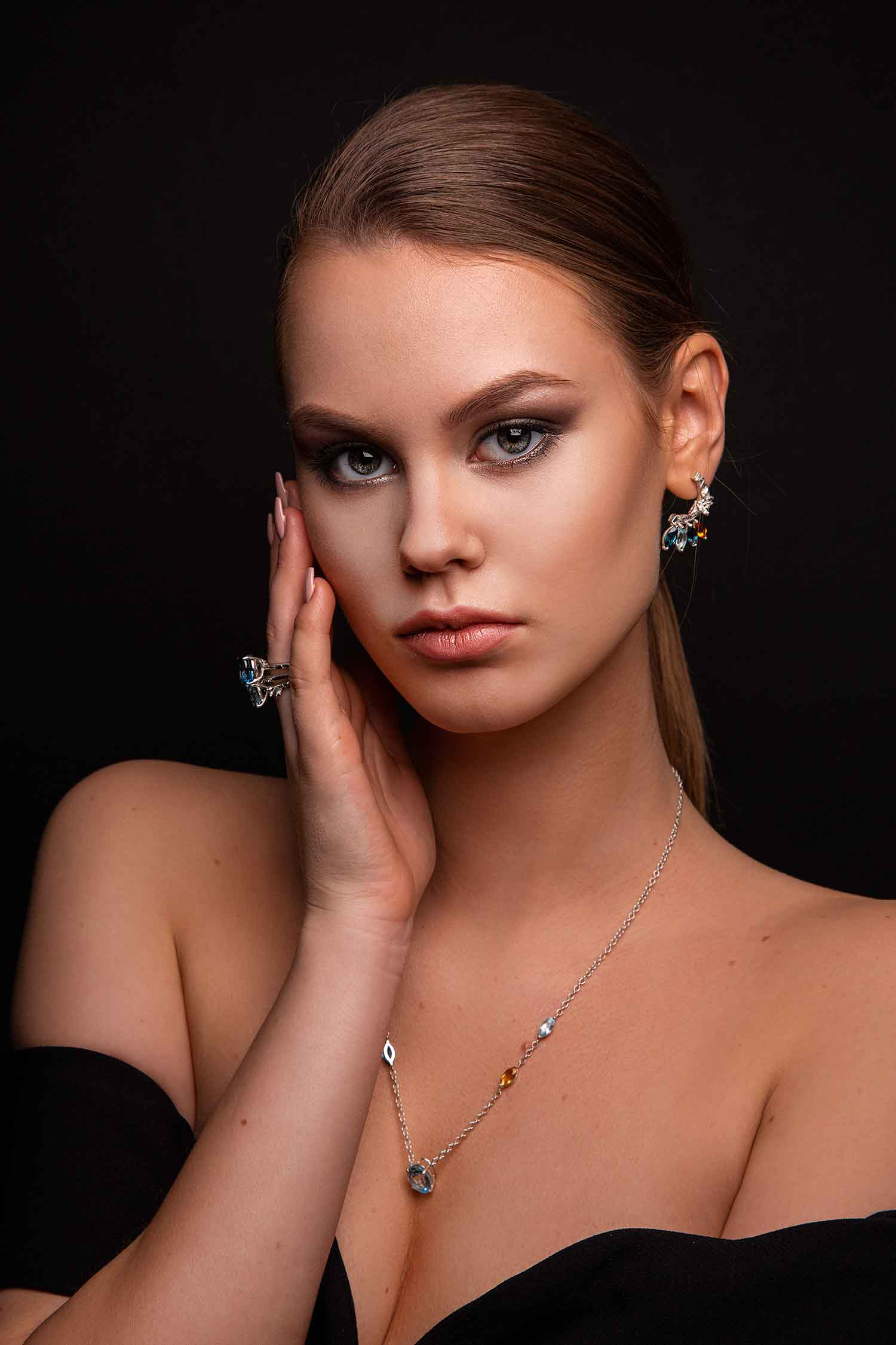 Model in lavish black dress wearing Zydrune high-end gemstone jewellery set.