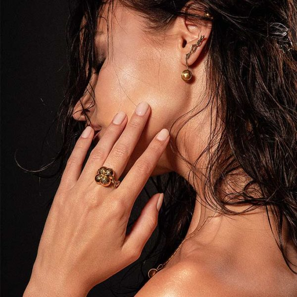 Zydrune jewellery medieval collection model wearing 4 orb gold vermeil ring.