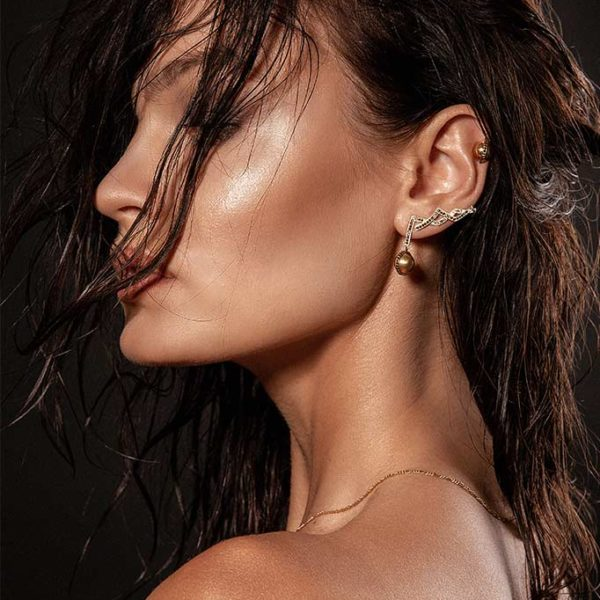 Zydrune jewellery medieval collection model with gold diamond stud earrings profile.