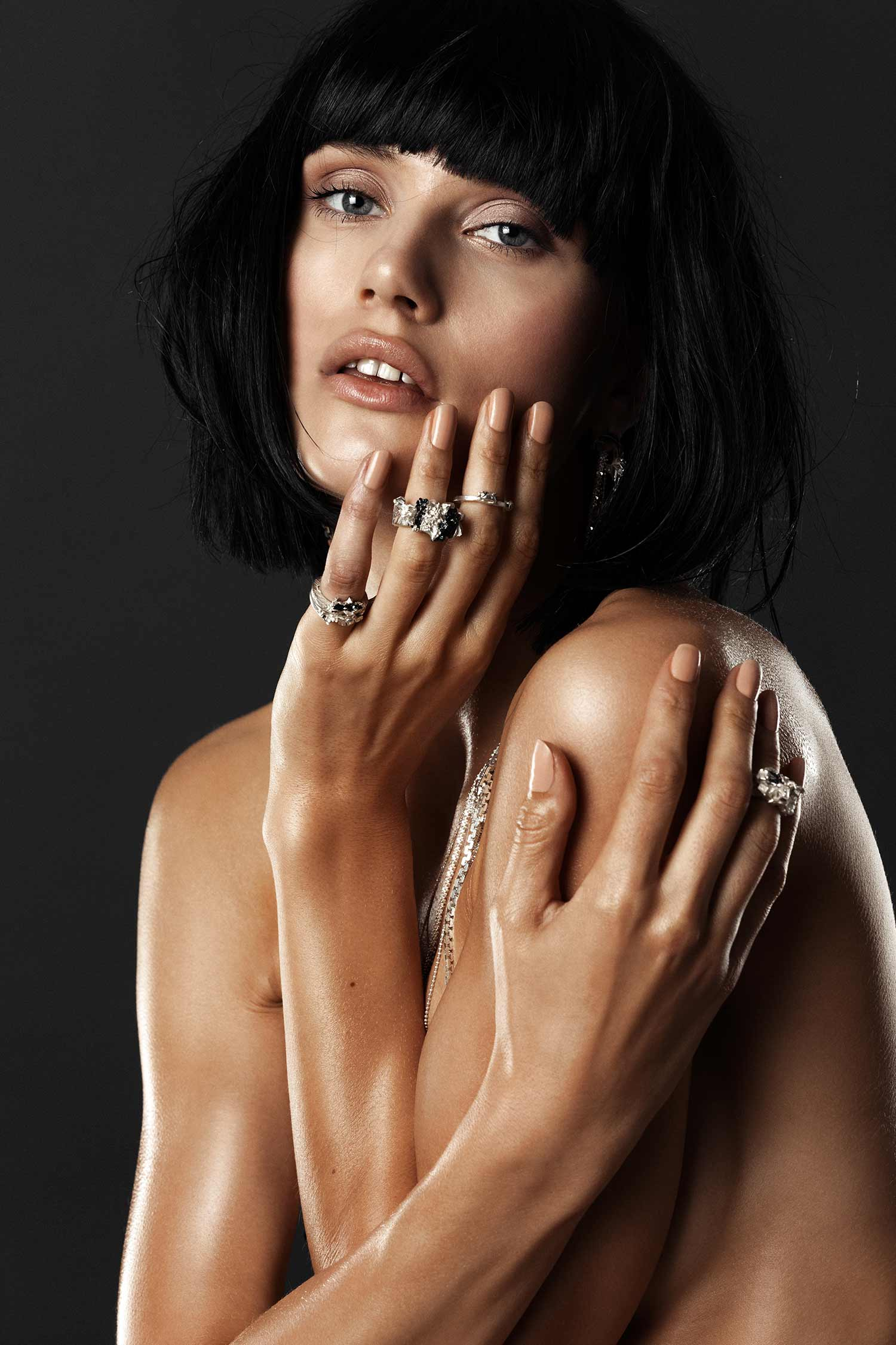 Model wearing ZYDRUNE Anomaly rings available to purchase at Harvey Nichols.